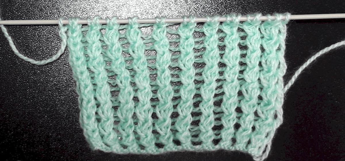 накид спицами в узорах вязания по фото и видео уроках